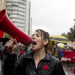 Despite the persistent rainfall, protesters marched downtown on Saturday Sept. 22 in a demonstration organized by Coalition Large de l'Association pour un Solidarité Syndicale Étudiante (CLASSE). (Luke Orlando / McGill Tribune)