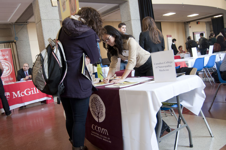 The Canadian College of Naturopathic Medicine booth at the SUS grad school fair. (Simon Poitrimolt / McGill Tribune)