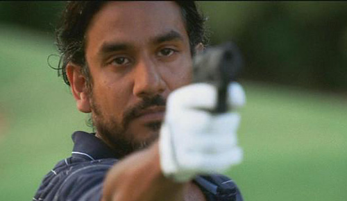 sayid points a gun to the viewer
