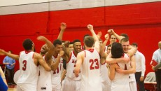 The Redmen celebrate their RSEQ win. (Mayaz Alam / McGill Tribune)